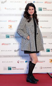 Rosabell Laurenti Seller chose a classic red carpet look when she sported this gray tweed coat.