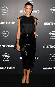 Rachel Finch chose a patent leather pencil skirt to top off her monochromatic evening look.