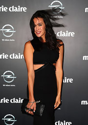 Megan Gale paired a black leather clutch with a cutout LBD for her Prix de Marie Claire Awards look.
