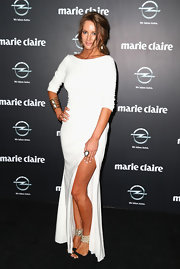 Samantha Wills chose a floor-length white gown with a front leg slit for her look at the Prix de Marie Claire Awards.