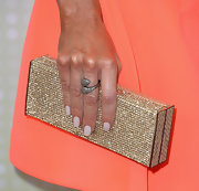 Denis Richards chose this golden crystal clutch for her red carpet look.