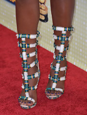 Coco Jones' plaid gladitor heels showed off her unique style.