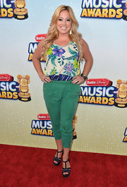 Sabrina Bryan chose this tropical-print blouse for her fun and flirty red carpet look at the Radio Disney Music Awards.