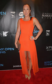 Jelena Jankovic sported a tangerine-colored evening dress with a cool fishtail hem.