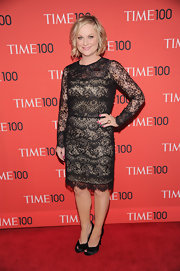 Amy Poehler chose a classically elegant long-sleeve lace frock for her look at the Time 100 Gala.