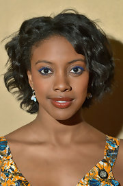 Condola Rashad rocked a vibrant blue mascara and subtle shadow for her look at the Tony Awards Nominees Reception.