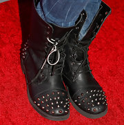Saxon Sharbino proved that studs and the red carpet do go together with this studded motorcycle boot.