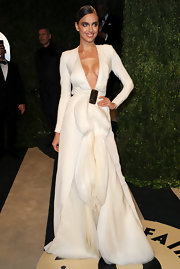Irina Shayk's long-sleeved white gown with a deep v-neck was a sexy and daring choice for the Oscar watch party hosted by Vanity Fair.