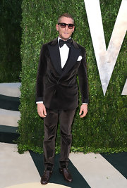 Lapo Elkann went to the 2013 Vanity Fair Oscar party wearing a black velvet tux and wayfarers.
