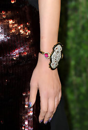 Wendi Deng had a green and purple combo for her moon manicure at the 2013 Vanity Fair party.