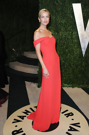 Carolyn Murphy opted for an elegant off-the-shoulder orange dress for her evening look at the Vanity Fair Oscar Party.