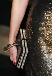 Vanessa Hudges sparkled with gold wave bangles detailed with champagne diamonds.