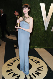 Anne Hathaway opted for a stylish column gown with a metallic sequin triangle neckline for her look at the Vanity Fair Oscar party.