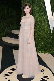 Zooey Deschanel loves feminine florals like the ones found on this long-sleeve pastel gown.