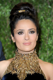 A good rule of thumb to learn from Salma: If go you dark on the eyes, go easy on the lips.