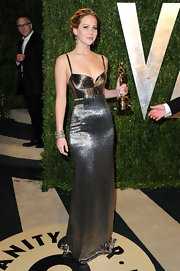 Jennifer Lawrence looked slender and sleek in this metallic silver gown, which she wore to the Vanity Fair Oscar party.