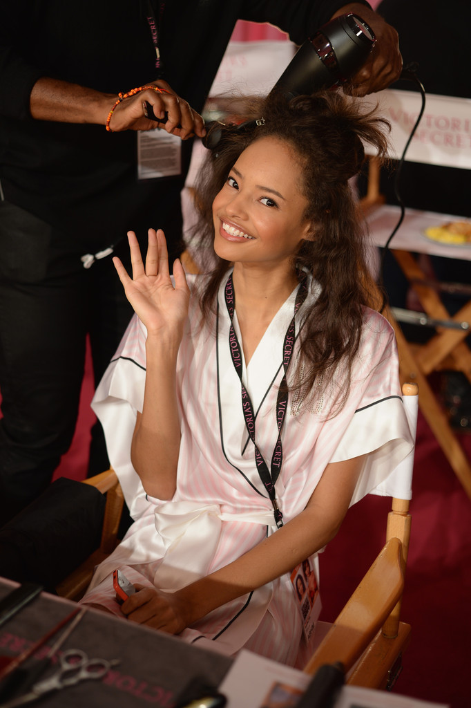 Model Malaika Firth prepares at the 2013 Victoria's Secret Fashion Show hair and make-up room at Lexington Avenue Armory on November 13, 2013 in New York City.