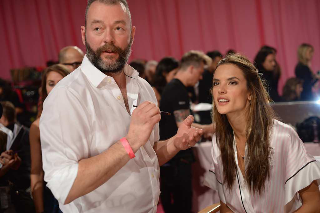 Lead Makeup Artist Dick Page prepares Victoria's Secret model Alessandra Ambrosio at the 2013 Victoria's Secret Fashion Show hair and make-up room at Lexington Avenue Armory on November 13, 2013 in New York City.