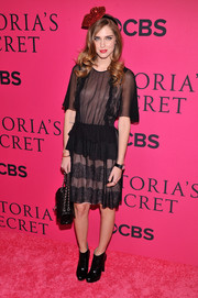 Chiara Ferragni complemented her sweet dress with edgy black ankle boots.