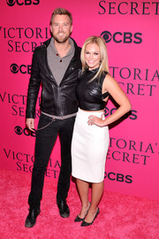 Cassie McConnell completed her ultra-chic ensemble with a pair of spiked black pumps.