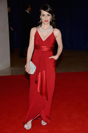 Constance Zimmer chose this elegant red gown with a satin waist and draped skirt for her red carpet look.