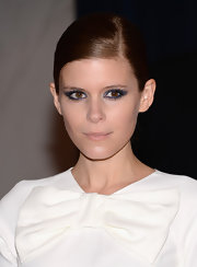 Kate Mara rocked her signature slick backed style with a deep side-parted bun.