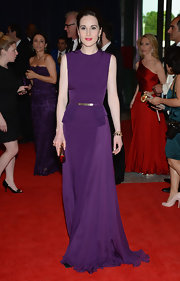 Michelle Dockery's sleek purple gown that featured a gold belted waist looked totally cool and contemporary on the British star.