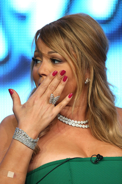 Mariah Carey played up her butterfly bling with a classic red mani.