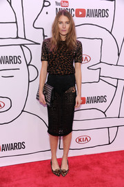 Dree Hemingway looked daring as she flashed some undies in a sheer black lace pencil skirt.