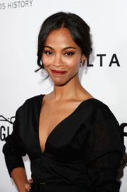 Zoe Saldana looked breathtaking with this loose bun at the amfAR Inspiration Gala.