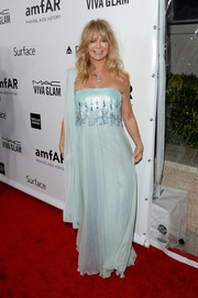 Goldie Hawn looked like a goddess at the amfAR Inspiration Gala in an embellished blue strapless gown by Tadashi Shoji.