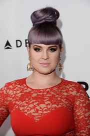 Kelly Osbourne added inches with this sky-high top knot when she attended the amfAR Inspiration Gala.