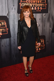 Reba McEntire kept it subdued with this black leather jacket and LBD combo at the American Country Countdown Awards.