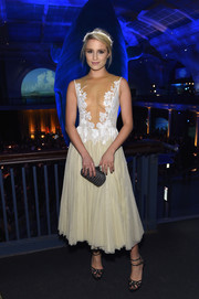 Dianna Agron wore a deceptively demure cream-colored lace and tulle cocktail dress, featuring a see-through bodice, to the American Museum of Natural History Gala.