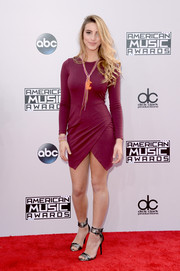 Lele Pons donned a modern purple mini dress with a wrap-style, geometric-hem skirt for the American Music Awards.