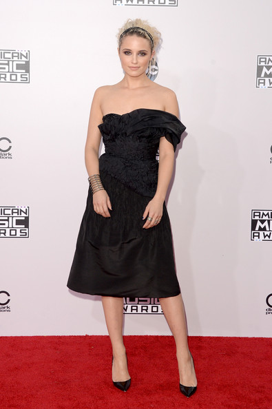 Dianna Agron managed to look sweet and edgy at the same time in a textured black off-one-shoulder dress by Marchesa during the American Music Awards.