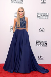 Kira Kazantsev paired her top with a voluminous blue skirt.