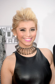 Kirstie Maldonado sported a very high pompadour at the American Music Awards.