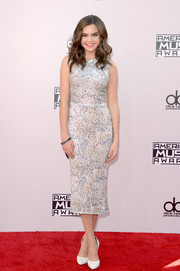 Bailee Madison hit the American Music Awards red carpet looking ultra chic in a metallic cocktail dress by Walter Mendez.