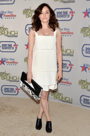Rose McGowan looked all set for summer in a tiered white Ruffian shift dress during the Garden Brunch.