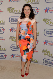 Julia Louis-Dreyfus added an extra pop of color with a pair of red Rupert Sanderson Elba pumps.