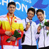 Gold medalist (C) Ryosuke Irie of Japan, Silver medalist (L) Jiayu Xu of China and Bronze medalist (R) Kosuke Hagino of Japan pose atop the podium after the Men's 100m Backstroke Final during day two of the 2014 Asian Games at Munhak Park Tae-Hwan Aquatics Center on September 21, 2014 in Incheon, South Korea.