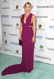 Kate Hudson wowed in a fuchsia Stella McCartney gown, boasting side cutouts, a plunging neckline, and a long train, at the Baby2Baby Gala.