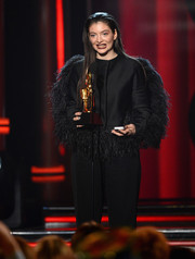 Lorde looked flamboyant in a feather-embellished black jacket by Lanvin at the 2014 Billboard Music Awards.