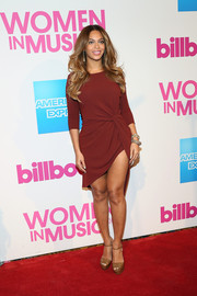Beyonce Knowles flaunted lots of thigh in a maroon Haute Hippie mini, featuring an asymmetrical hem and knot detailing, during the Billboard Women in Music luncheon.