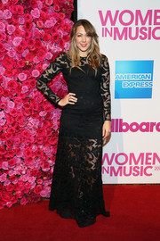 Colbie Caillat was sexy-goth at the Billboard Women in Music luncheon in a black lace gown with a sheer skirt, yoke, and sleeves.