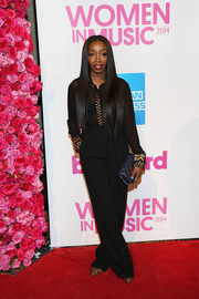 Estelle completed her Billboard Women in Music red carpet look with high-waisted black pants.
