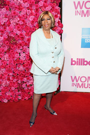 Aretha Franklin paired her suit with classic cap-toe slingbacks.