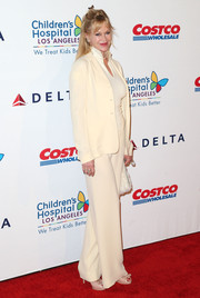 Melanie Griffith kept it conservative yet classy in a cream-colored pantsuit during the CHLA gala.