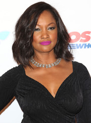 Garcelle Beauvais went for an electrifying beauty look with bright purple lipstick.